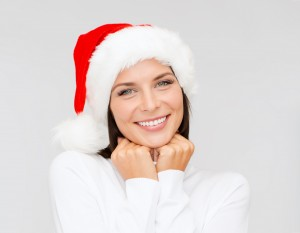 christmas, xmas, winter, happiness concept - smiling woman in santa helper hat