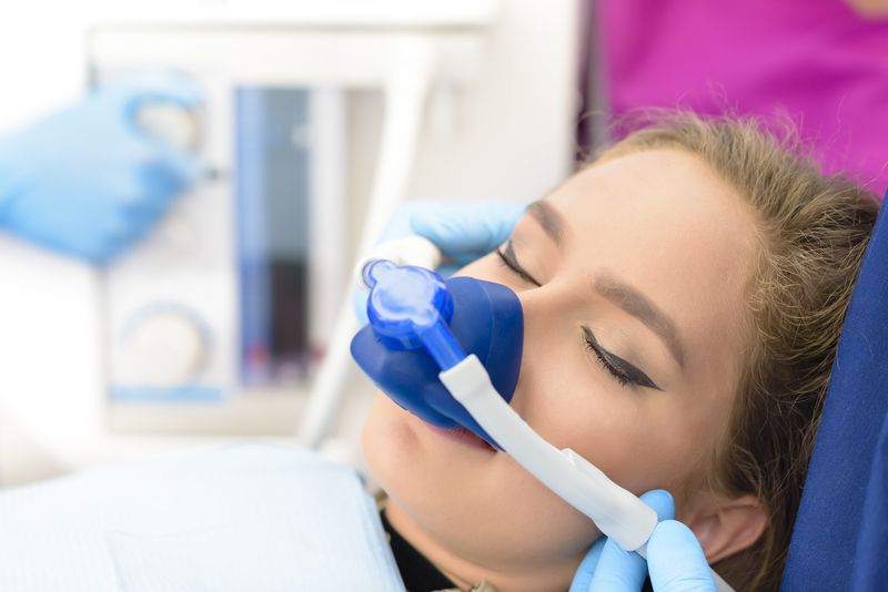 Woman that is receiving laughing gas as her dental anesthesia.