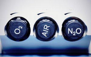 Close-up view of laughing gas knobs that say O2, AIR, and N2.