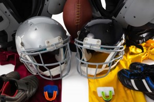 An assortment of helmets, jerseys and mouthguards for football.