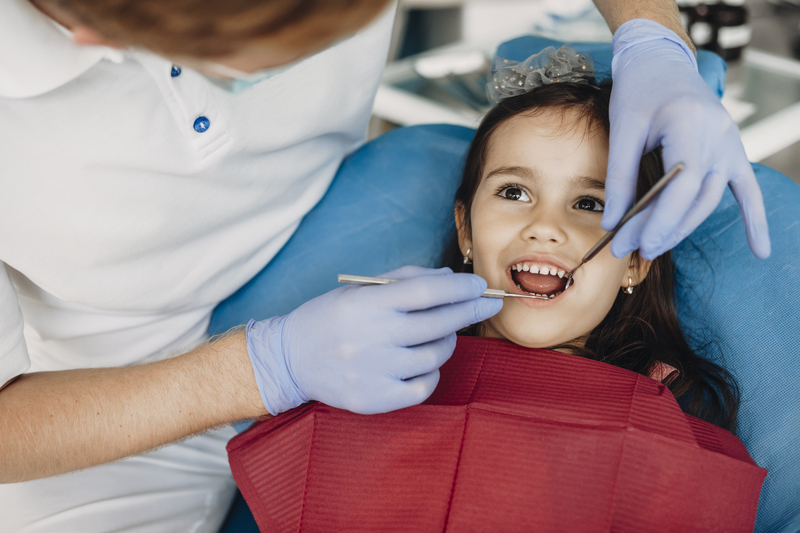 Little girl having teeth worked on at the dentist.