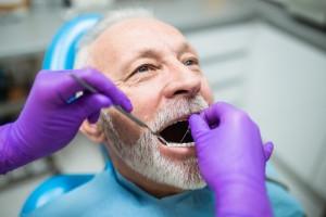 Close-up view of a senior citizen man having a dental exam.
